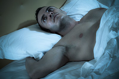Man uncomfortable in bed